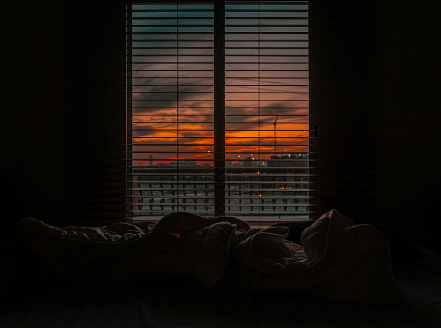 A bed in a dark room